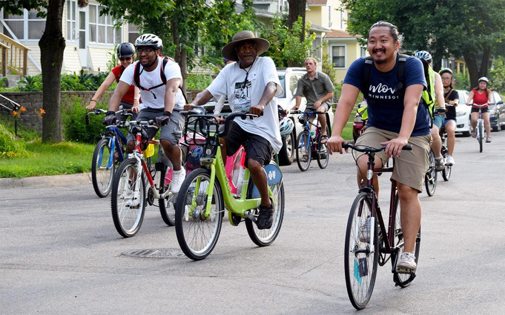 Move Minnesota staff leading a bike ride with community members