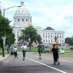 People scootering in Saint Paul