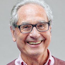 Smiling mature man with glasses and receding hair