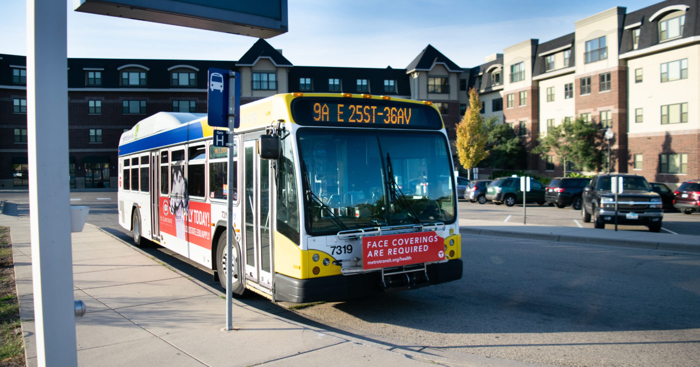 Metro Transit bus in front of multifamily housing in the Twin Cities